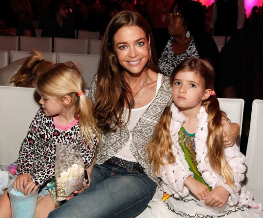 "Actress Denise Richards and daughters Sam Sheen (R) and Lola Rose Sheen (L) attend Nickelodeon's exclusive premiere for ""iParty with Victorious,"" Saturday, June 4, 2011 in Los Angeles."