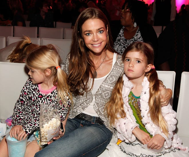 """HOLLYWOOD, CA - JUNE 04:  Actress Denise Richards (C) and daughters Sam Sheen (R) and Lola Rose Sheen (L) attend Nickelodeon's exclusive premiere for the upcoming primetime TV event of the summer. """"iParty with Victorious,"""" Saturday, June 4, 2011 at The Lot in Los Angeles."""