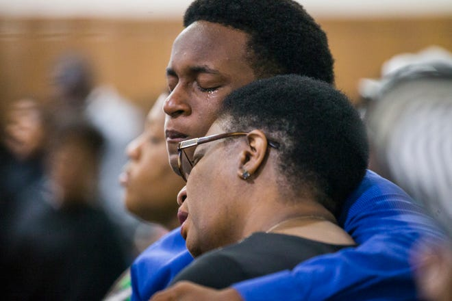 Allison Jean and her son Grant, 15, mourn Botham Jean, Allison's son and Grant's brother during a prayer service for Jean at the Dallas West Church of Christ on Sept. 9, 2018.