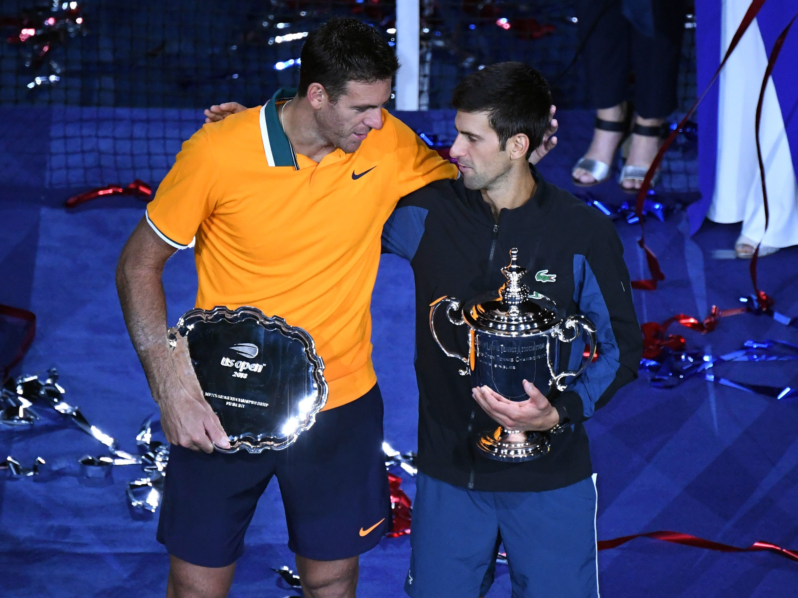 Novak Djokovic and Juan Martin del Potro embrace after the US Open final.