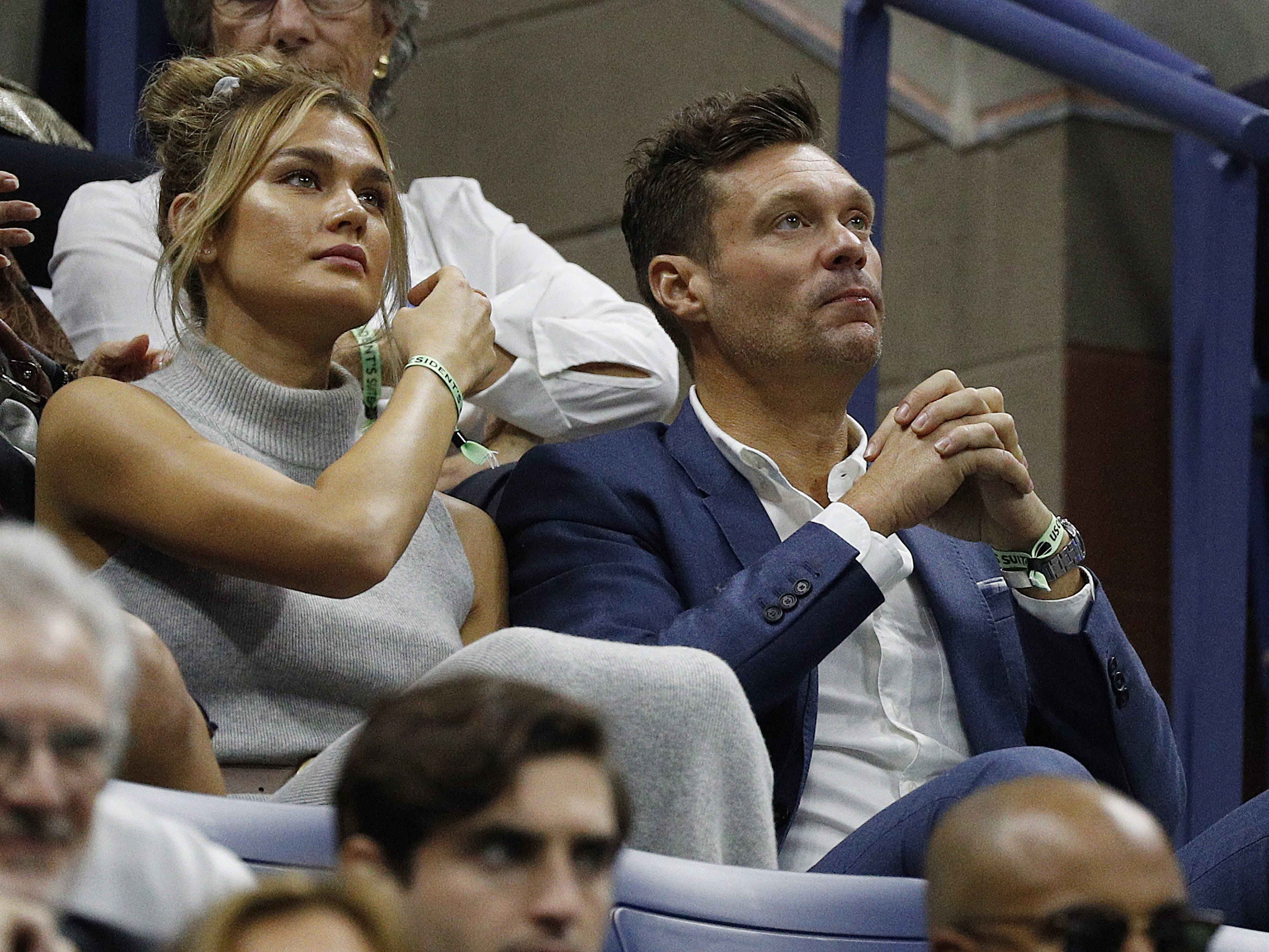 TV personality Ryan Seacrest, right, watches the men's final between Novak Djokovic and Juan Martin del Potro.