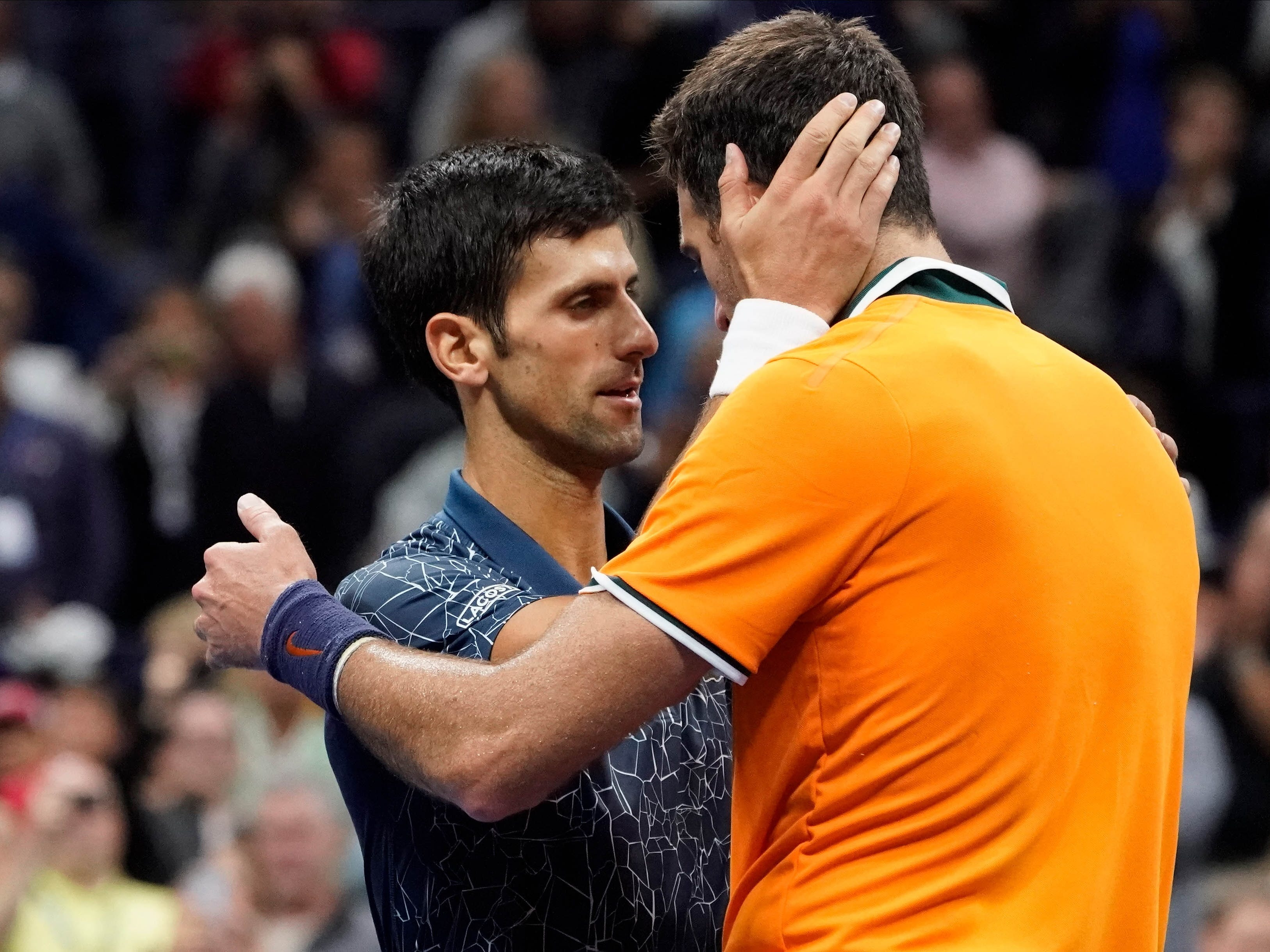 Novak Djokovic gets a hug from Juan Martin del Potro after an exhausting US Open final.