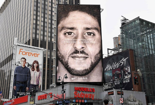 A Nike Ad featuring American football quarterback  Colin Kaepernick is on display Sept. 8 in New York City. Not all cities have been as welcoming. Nike's new ad campaign featuring Kaepernick, the American football player turned activist against police violence, takes a strong stance on a divisive issue that reportedly has upset a Louisiana city mayor.