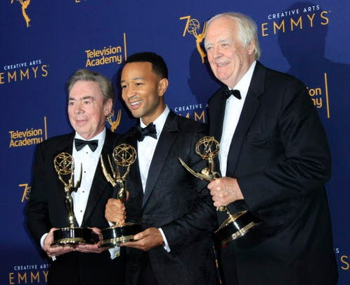 """Composer Andrew Lloyd Webber, left, singer-songwriter John Legend and author Tim Rice are now part of the elite group of EGOT winners – Emmy, Grammy, Oscar and Tony. The three won outstanding variety special Emmy Awards on Sunday for the live-action """"Jesus Christ Superstar Live in Concert."""" The 70th Primetime Emmy Awards Ceremony will take place on Sept. 17."""