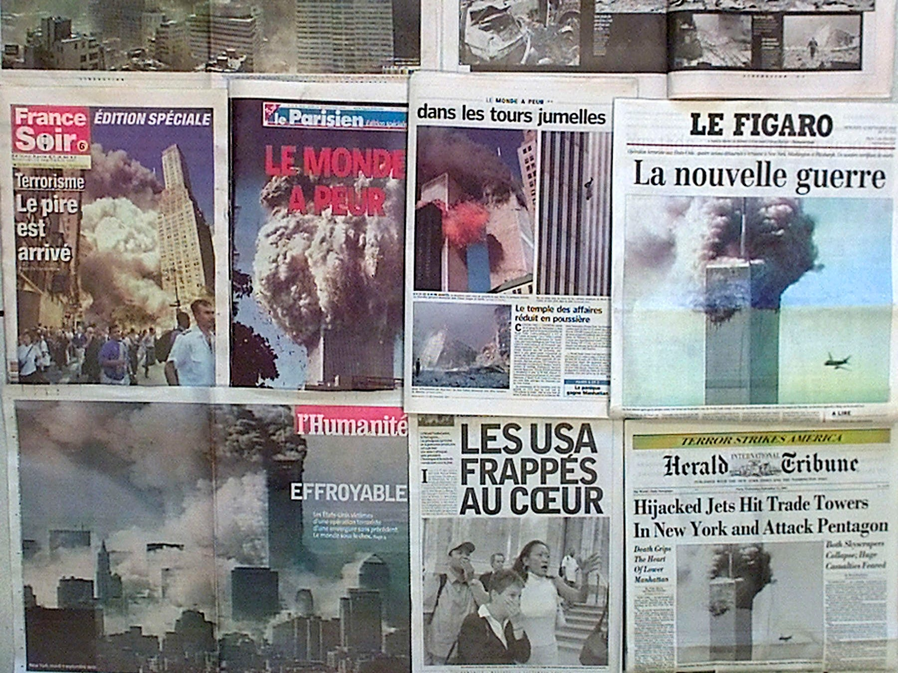 "French national newspapers in Paris Wednesday, Sept. 12, 2001, covering Tuesday's terrorist attacks in the United States.  Headlines read, top: ""11 o'clock in Manhanttan"", middle from left: ""The worst has arrived"", ""The world is afraid"", ""The new war"", and bottom from left: ""Horrendous"", ""The US hit at the heart"". (AP Photo)"