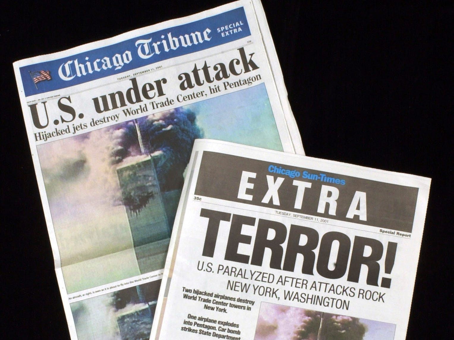 Special  extra editions of the Chicago papers are published  on the terroist attack on the World Trade Center towers in New York, Tuesday, Sept. 11, 2001 (AP Photo/Charles Bennett)