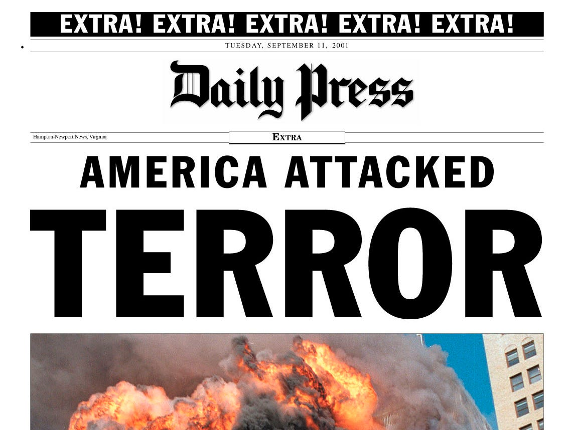 The front page of the Daily Press extra edition is shown Tuesday, Sept. 11, 2001, in Newport News, Va., after the attacks on New York and Washington. The picture shows the World Trade Center in New York City in flames. (AP Photo/Daily Press)