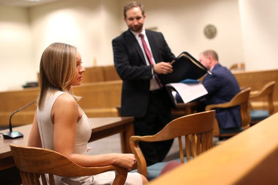 Natalie Coenen, of Appleton, looks back at her family after her plea hearing at the Outagamie County Justice Center on Friday in Appleton.