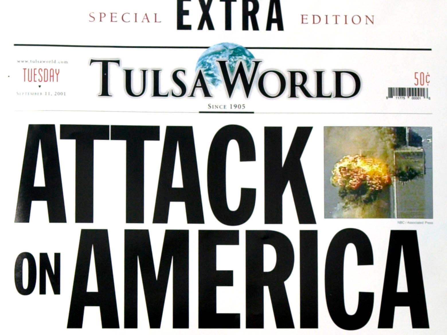 The Tulsa World special extra edition on the terrorist attacks in New York and Washington, its first special edition since World War II, is shown Tuesday, Sept. 11, 2001, in Tulsa, Okla. (AP Photo/Tulsa World, Tom Gilbert)