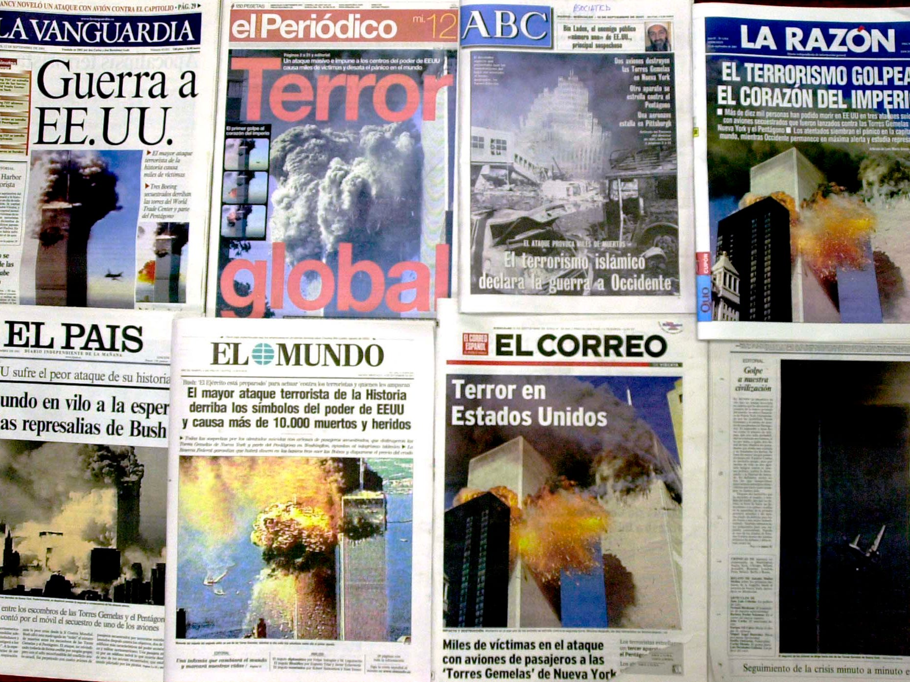 Front pages of Spanish newspapers are pictured in Madrid, Spain Wednesday Sept. 12, 2001 showing coverage of the terrorist attacks in New York and Washington DC. (AP Photo/Paul White)