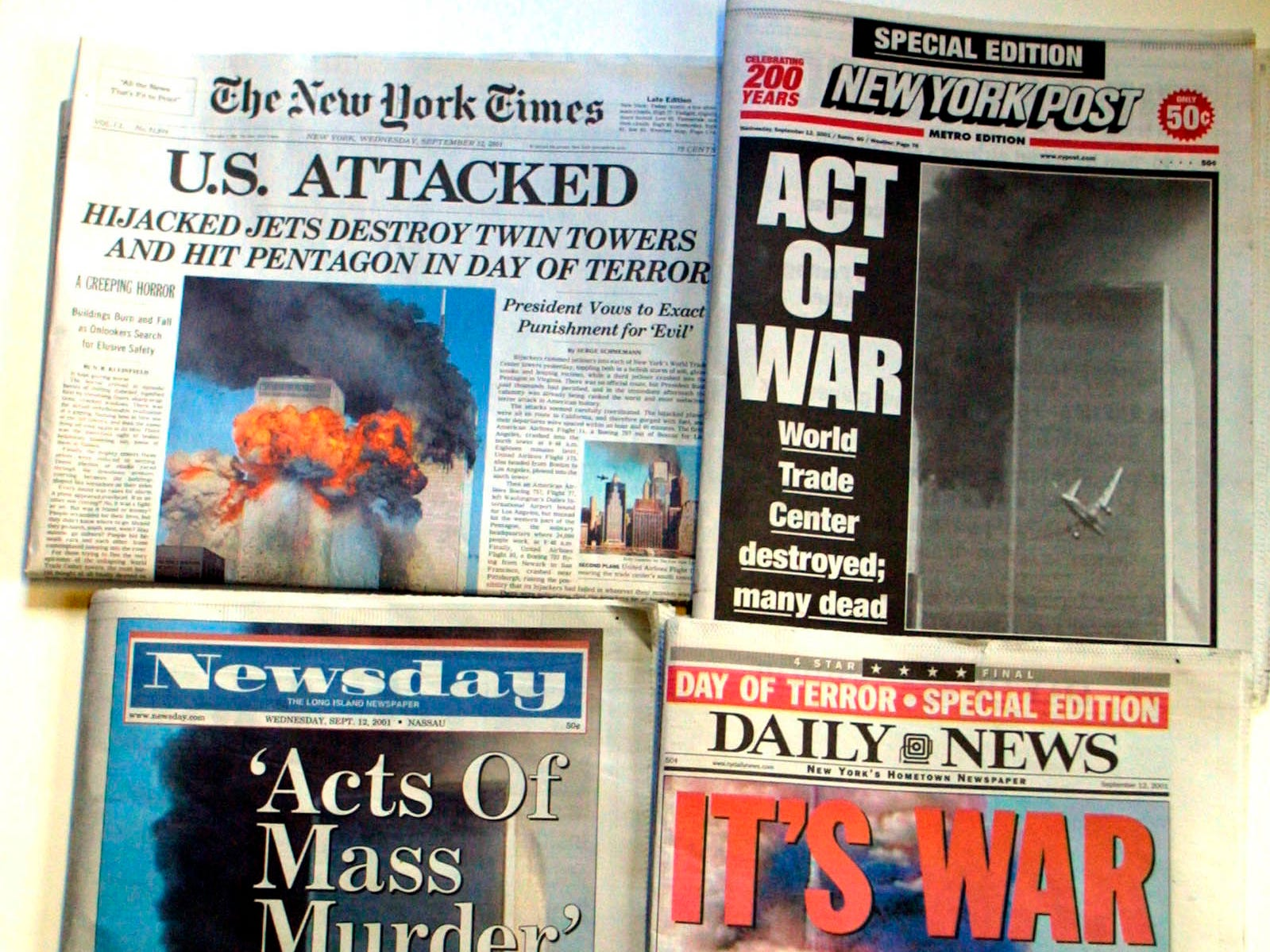 The New York newspapers Wednesday, Sept. 12, 2001, show coverage of the terrorist attack on the World Trade Center. (AP Photo/Diane Bondareff)