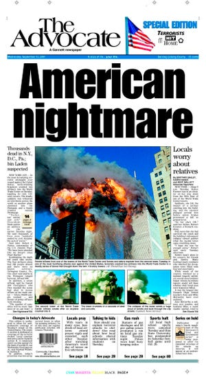 This is the front page of The Advocate in Newark, Ohio, as seen early Wednesday, Sept. 12, 2001.  The photographs show the attacks on the World Trade Center in New York on Tuesday morning. (AP Photo/The (Newark, Ohio) Advocate)