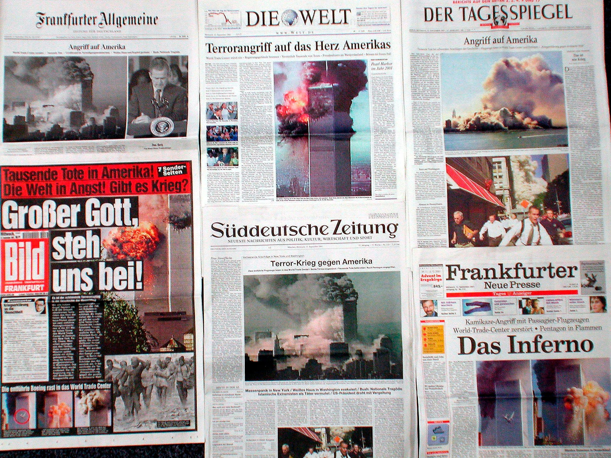 Front pages of German newspapers are pictured, in Frankfurt, Germany, showing coverage of the terrorist attacks in New York and Washington, Wednesday, Sept. 12, 2001. Among them the 'Frankfurter Allgemeine Zeitung' , top left, which features two photos on its front page, the first time printed photos appeared on its front. (AP Photo/Udo Weitz)