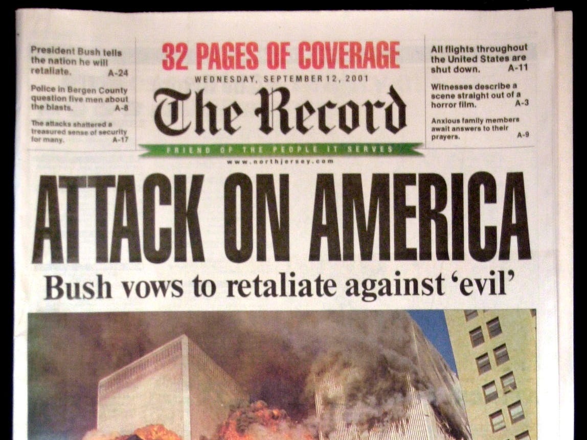 This is the cover of the first edition of the Wednesday, Sept. 12, 2001, edition of The Record in Hackensack, N.J., with coverage of the attacks on the World Trade Center in New York. (AP Photo/The Record)
