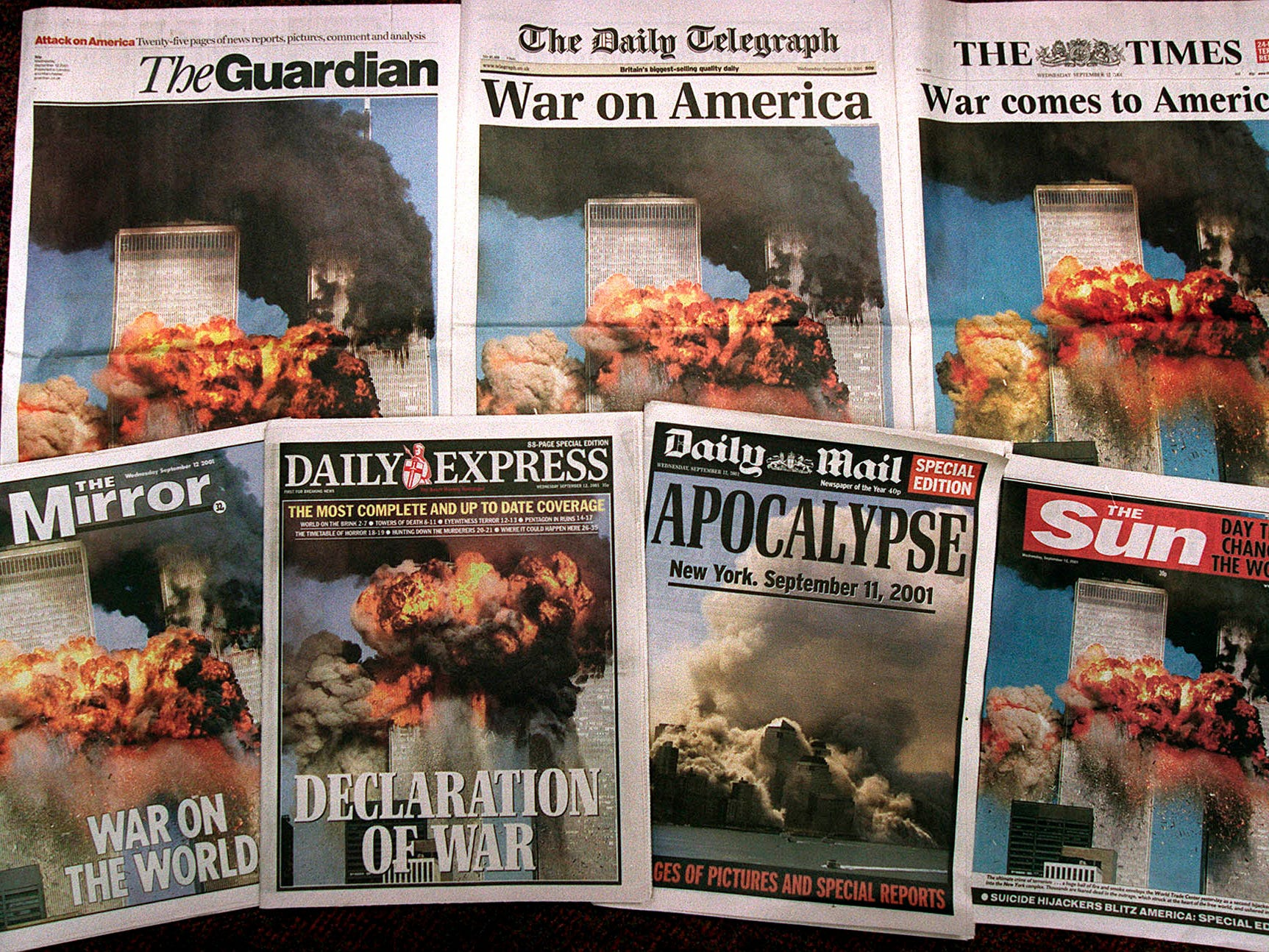 Front pages of the British national newspapers are seen Wednesday, Sept. 12, 2001. Photos and stories of the attacks in New York and Washington dominated the front pages. (AP Photo/Martin Cleaver)