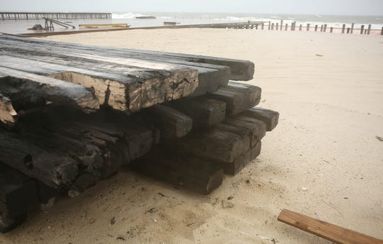 Old burnt timbers are stacked up on the beach near Porter Ave. Seaside Park, New Jersey. Monday, September 10, 2018. David Gard /Correspondent