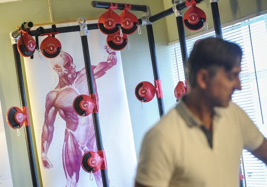 Chris Verdi, owner of Core Restore in Allenhurst, specializes in muscle movement training and Muscle Activation Techniques (MAT) on Sept. 10, 2018.