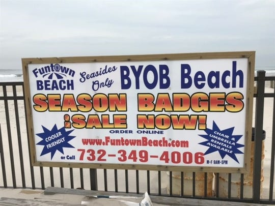 A sign advertises the BYOB beach near the former site of the Funtown Pier in Seaside Park.