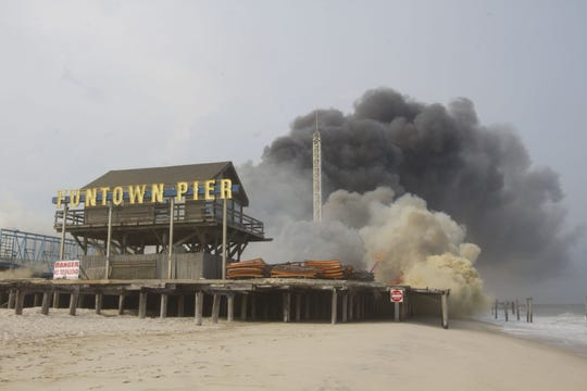 A file photo shows the 2013 fire that destroyed parts of the Seaside Park and Seaside Heights boardwalks.