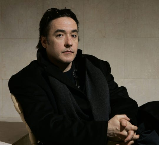 In this Jan. 21, 2007 file photo, actor John Cusack poses for a photograph during the Sundance Film Festival in Park City, Utah.