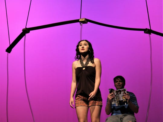 Chloe (Kira Tanner) sings about her growing fondness for the Bubble Boy (Price Payne), who is seated behind her in his protected space with a new magazine she provided in this rehearsal scene from Abilene High School's fall musical.