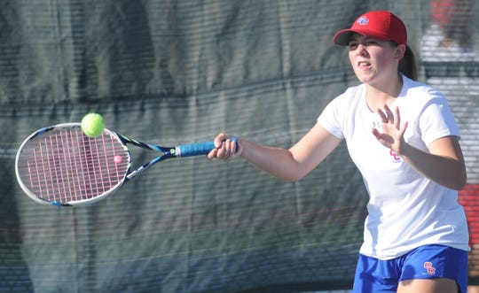 Cooper's Caroline Statler returns a shot against Wichita Falls Rider's Presley Smith in their girls singles match. Smith won 7-5, 6-1, and Rider beat Cooper 13-6 in the District 4-5A team tennis opener Monday, Sept. 10, 2018 at the Cooper tennis courts.
