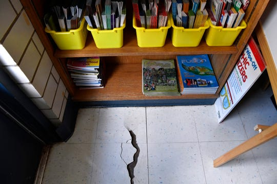 A crack is visible in the floor of a second-grade classroom at Dyess Elementary.