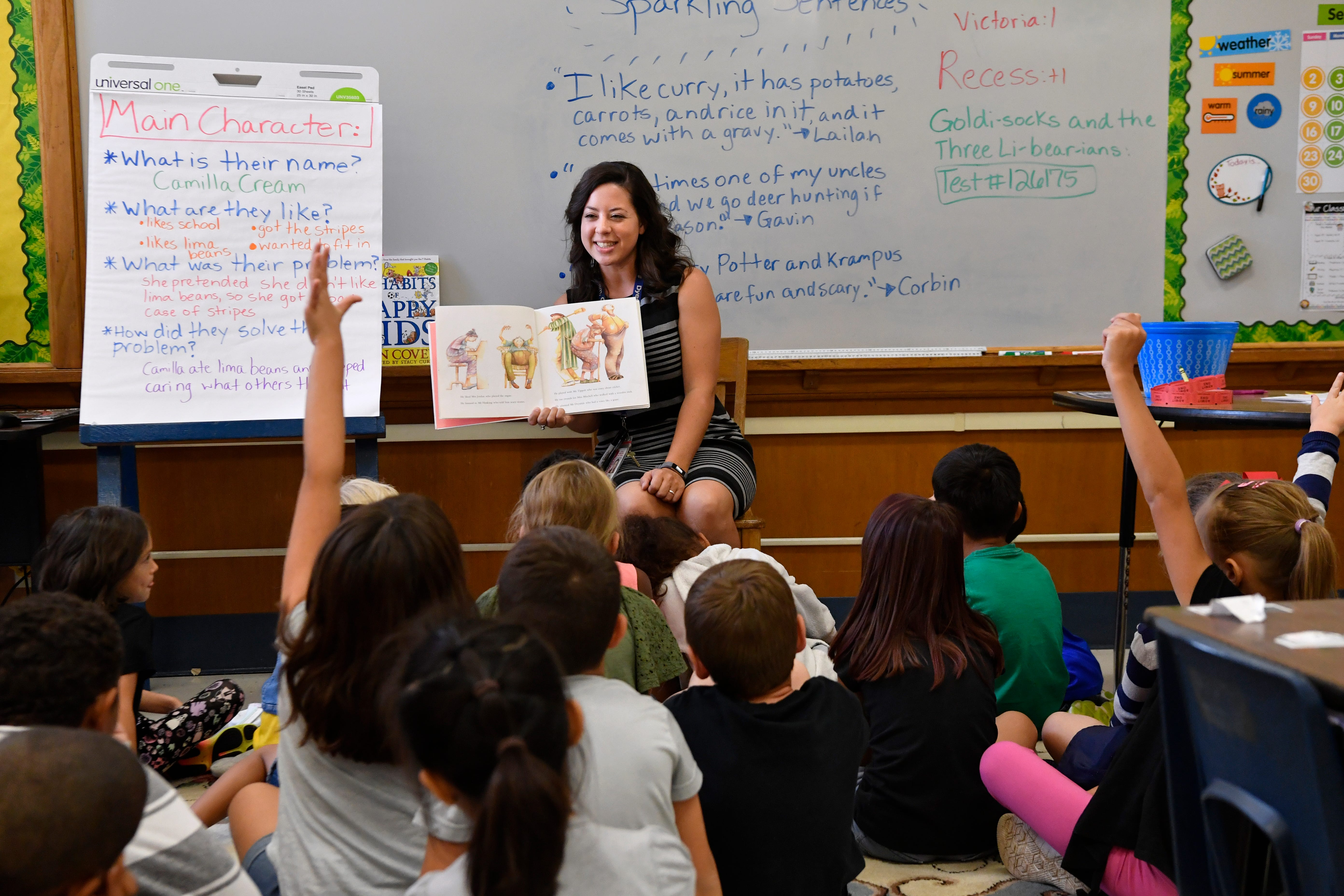 Paige Daugherty a second-grade teacher at Dyess Elementary School, reads to her class a book on memory Tuesday.