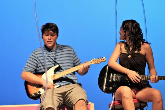 "The Bubble Boy, Jimmy (Price Payne) connects with Chloe (Kira Tannyer) through their shared interest in music in this rehearsal scene from ""Bubble Boy,"" the Abilene High School fall musical that will be performed 7 p.m. Thursday and 2 and 7 p.m. Saturday at the AHS auditorium."