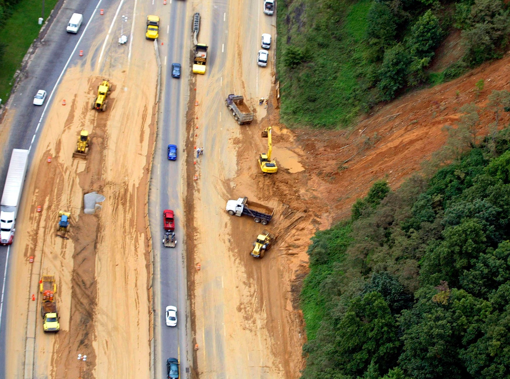 Workers try to clear a mud slide on Interstate 40 outside of Black Mountain on Sept. 9, 2004, after the remnants of Hurricane Frances brought heavy rains and flooding to the area.