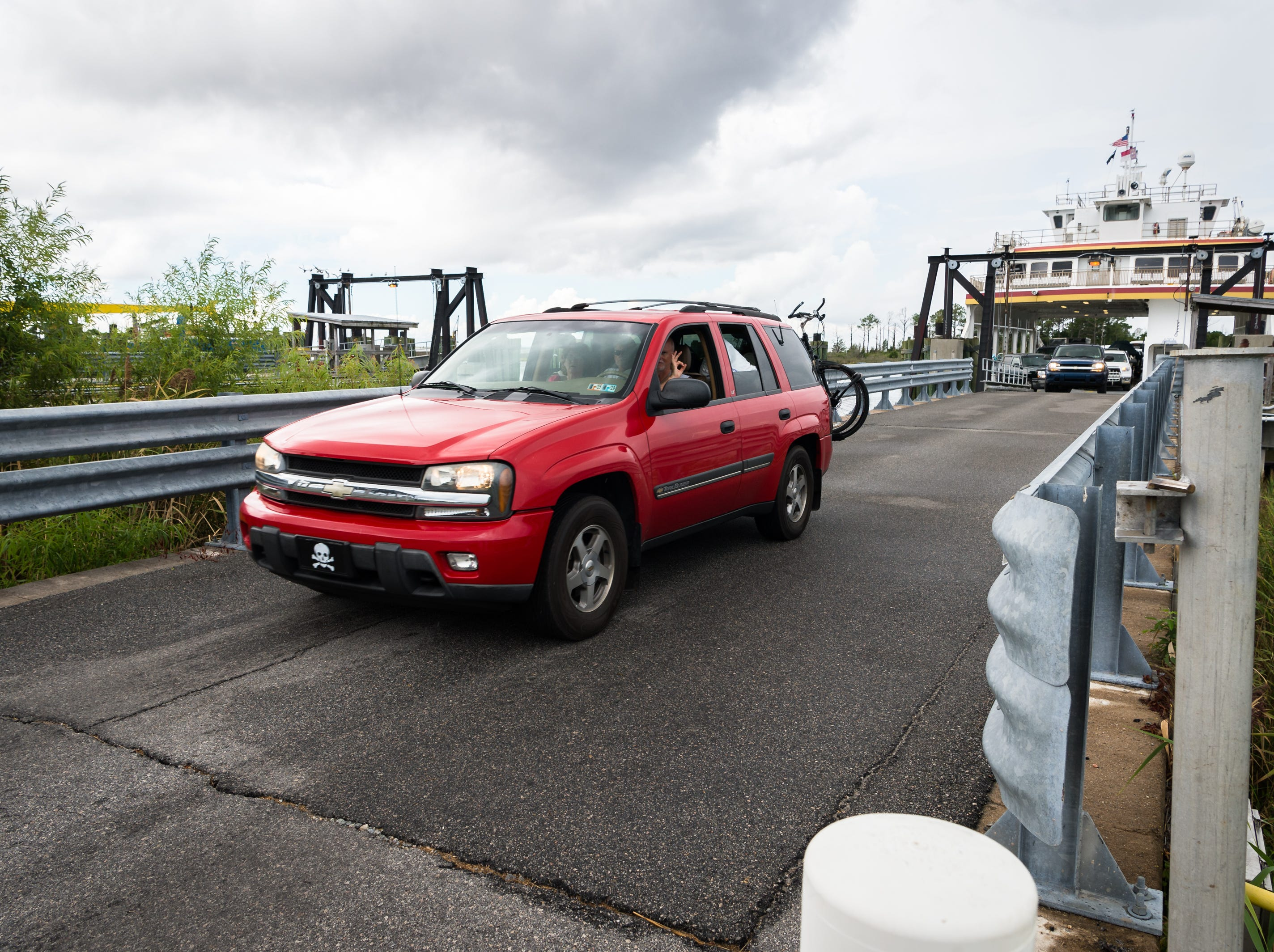 Passengers drive their cars off the Swan Quarter ferry after arriving at the terminal carrying a full load of passengers from Ocracoke Island Sept. 11, 2018, in accordance with the mandatory evacuation order in preparation for hurricane Florence.