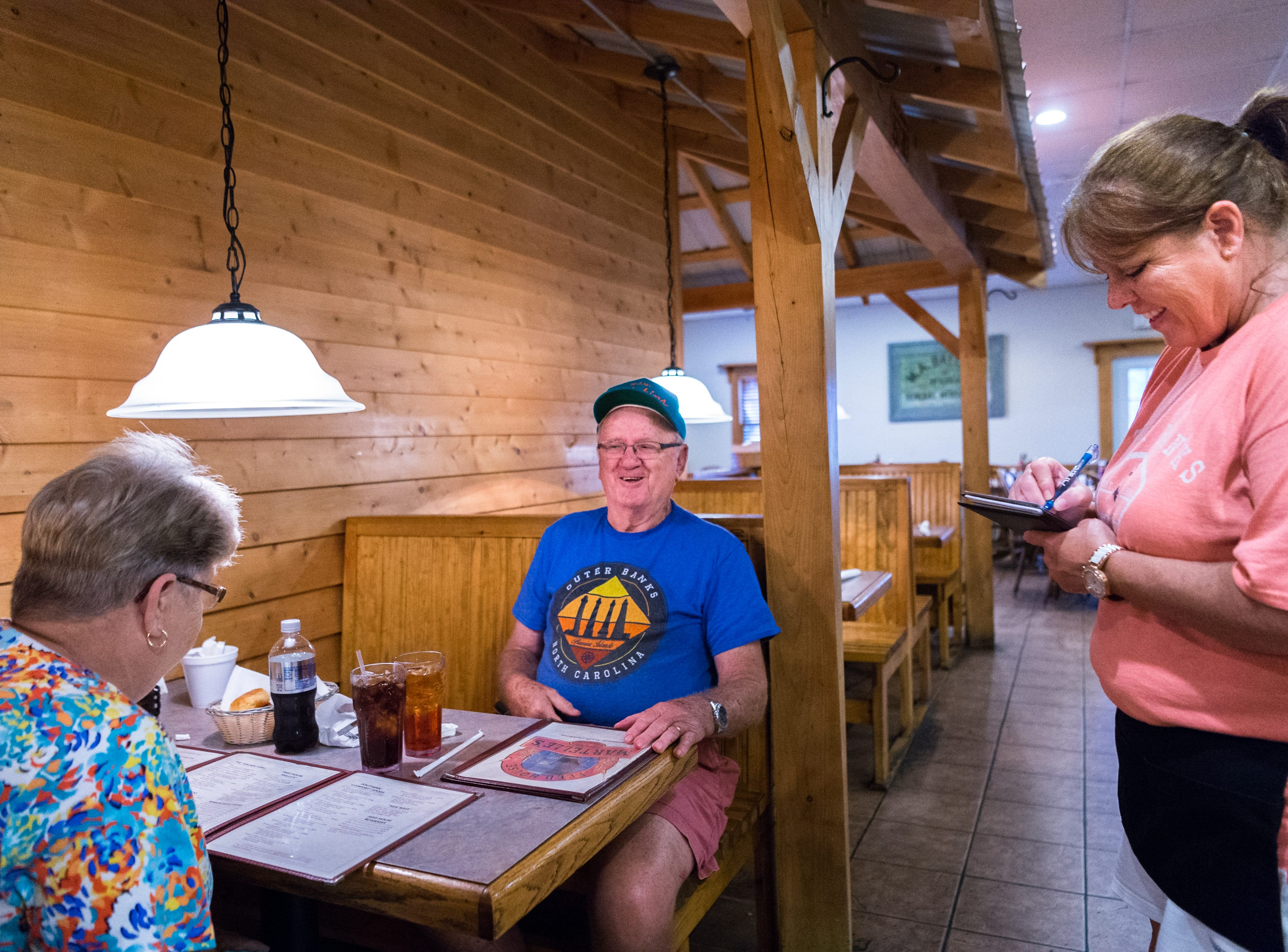 Pam Ransom and her husband George Ransom of Lake Landing, give their order to Sharon Selby at Martelle's Feed House restaurant in Engelhard before they evacuate to Virginia before Hurricane Florence makes landfall in Eastern North Carolina Sept. 11, 2018.
