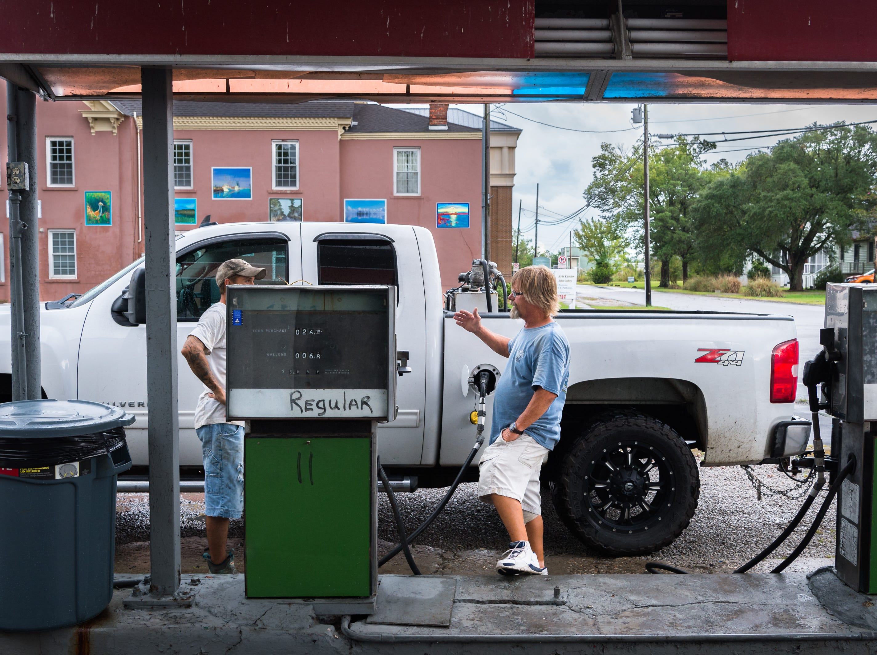 Tony Brooks fills up the gas tank of a customer at Ryan's Garage in Swan Quarter in preparation for Hurricane Florence Sept. 11, 2018.