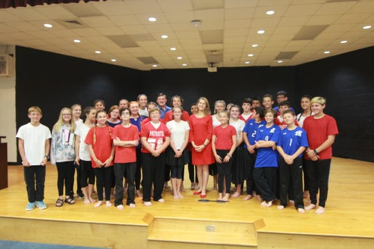 First Lady Kristin Cooper stands with Madison Middle School dancers following their performance.