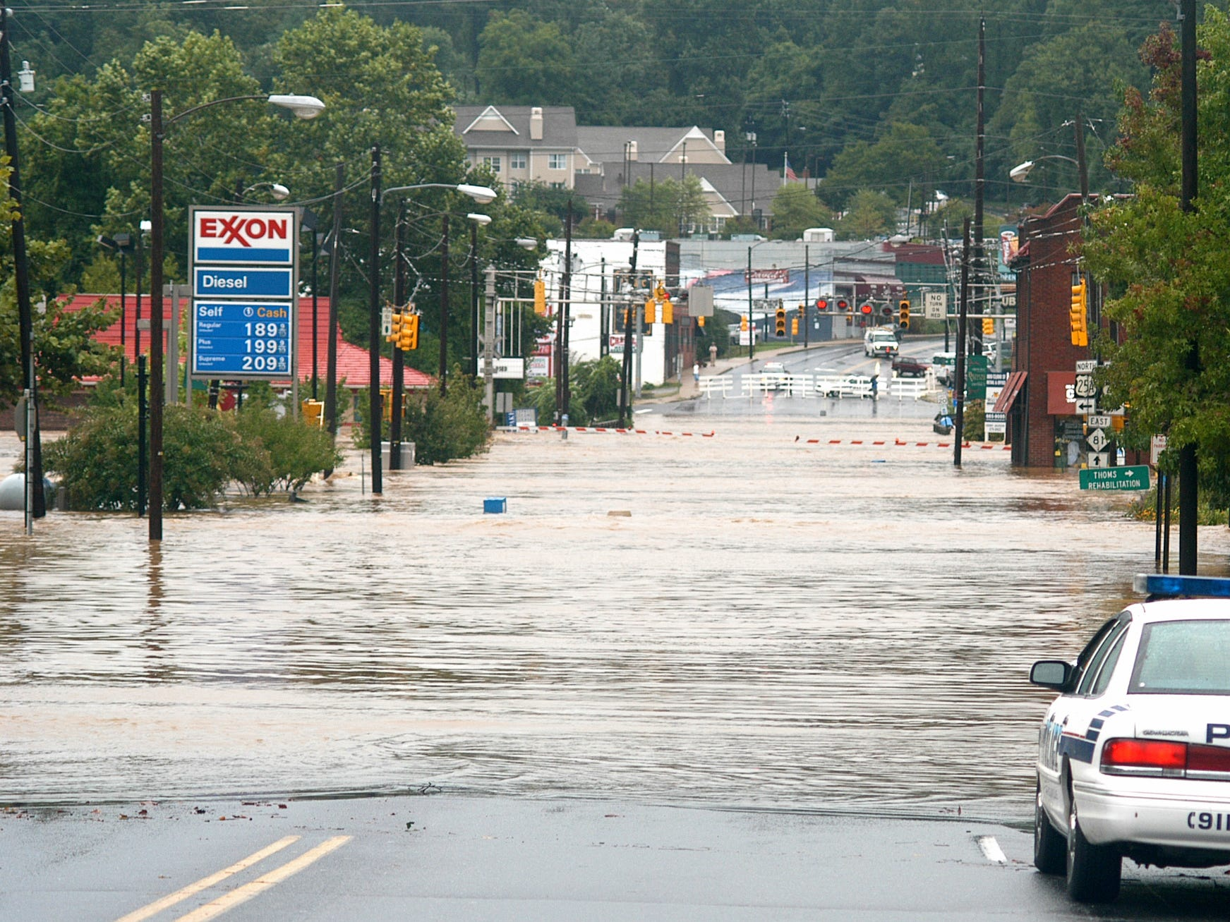 Police guard flooded Biltmore Avenue in Biltmore Village after the Swannanoa River overflowed its banks and flooded the area on Sept. 8, 2004. Heavy rain from Hurricane Frances flooded many areas of WNC.