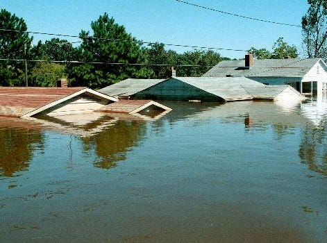 Water covers a row of houses in Tarboro, N.C., on Sept. 23, 1999. A week after Hurricane Floyd dumped 20 inches of rain, floodwaters were receding across much of eastern North Carolina. Across the soggy, 18,000-square-mile region, more than 700 roads remained flooded, the number of confirmed deaths inched up to 42, and thousands of people remain in shelters.