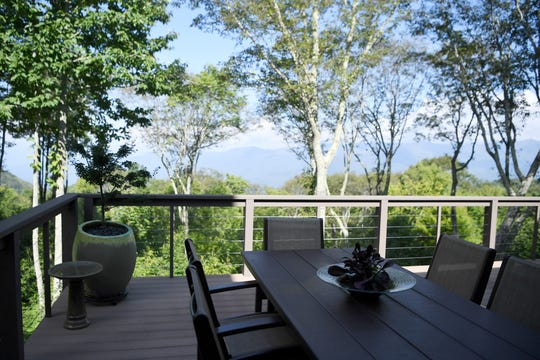 """The view from Jim and Sabrina Watson's balcony August 30, 2018. The couple was looking for """"long, layered views"""" when they settled on a mountaintop lot in the 4,400-acre, conservation-oriented master planned community of Balsam Mountain Preserve in Jackson County."""
