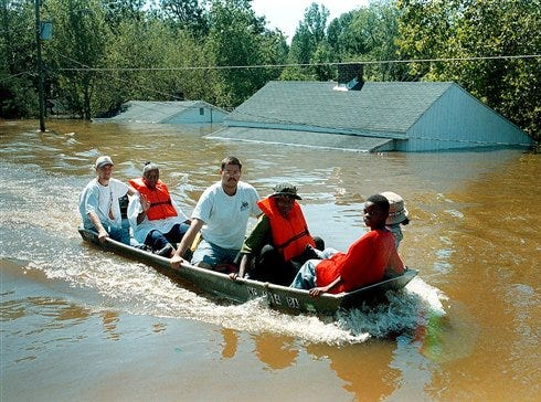 A boat carrying a group of Princeville, N.C., residents travels down Main Street after floodwaters from the Tar River completely flooded the town in this Sept. 17, 1999, photo. Hurricane Floyd dropped more than 20 inches of rain in eastern North Carolina after making landfall. Much like in New Orleans, it was the flooding that caused the damage, forcing more than 100,000 people into shelters, destroying 7,000 homes while damaging 56,000.