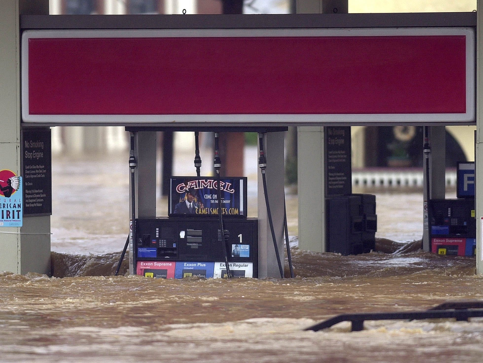 Floodwaters envelop a gas station in the Biltmore Village section of Asheville on Sept. 8, 2004. More than10 inches of rain, remnants of Hurricane Frances, caused massive flooding throughout Western North Carolina.