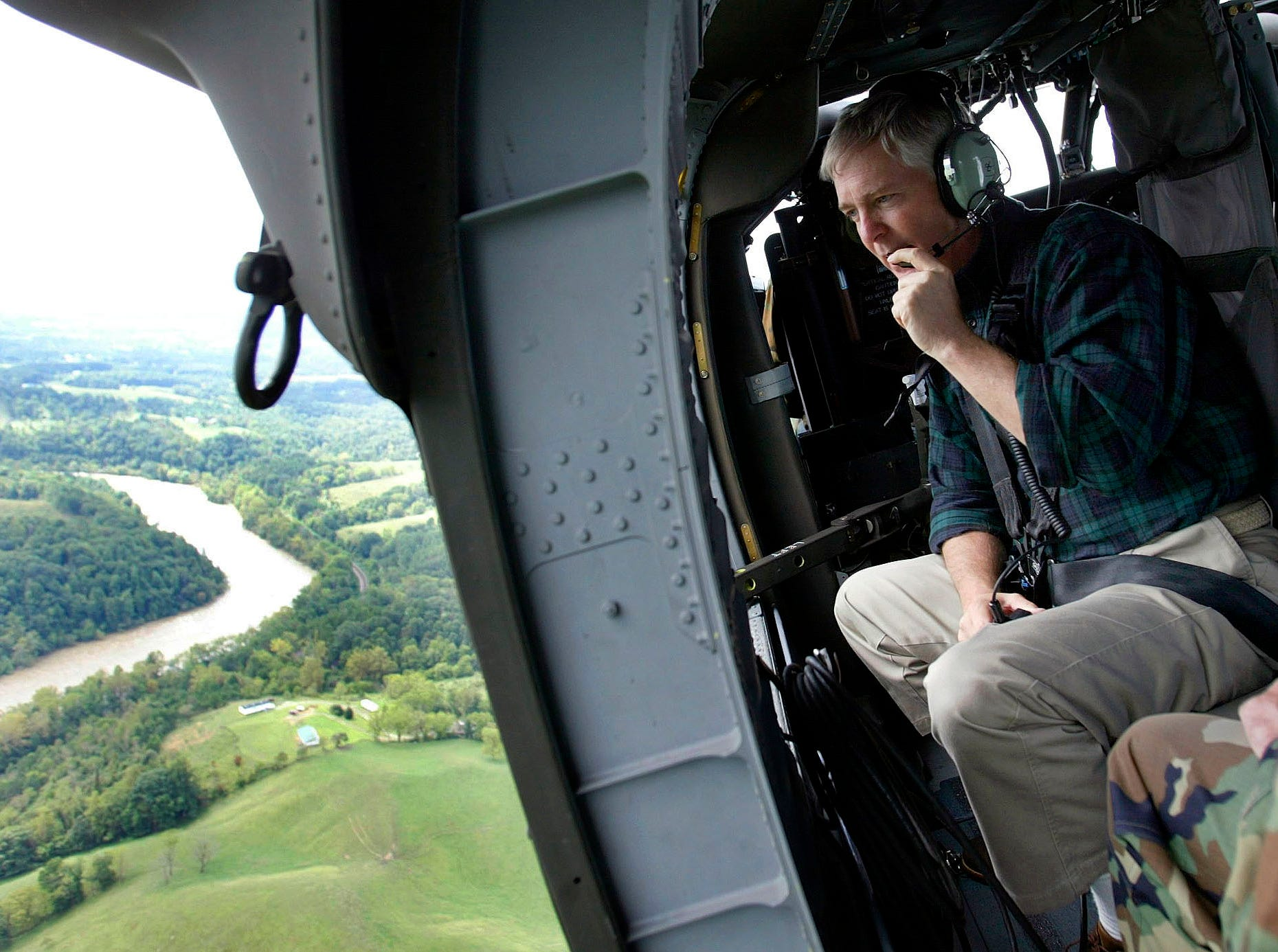 North Carolina Gov. Mike Easley looks out of a helicopter door at flood damage near Asheville on Sept. 9, 2004, after the remnants of Hurricane Frances brought heavy rains and flooding to the area.