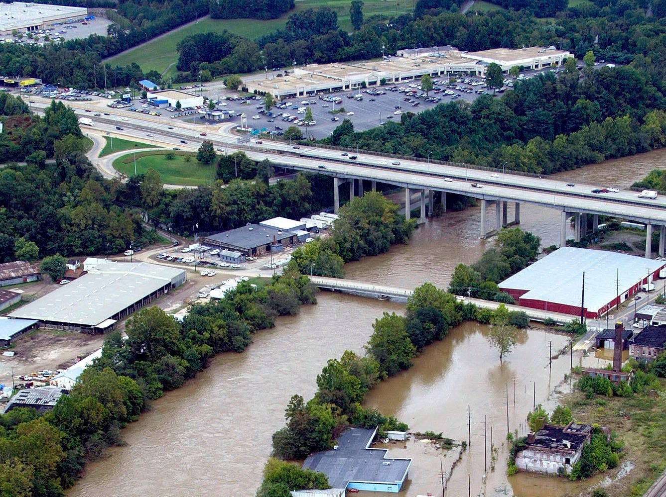 Businesses along the French Broad River in Asheville, N.C., are shown under water Thursday, Sept. 9, 2004, after the remnants of Hurricane Frances brought heavy rains and flooding to the area.