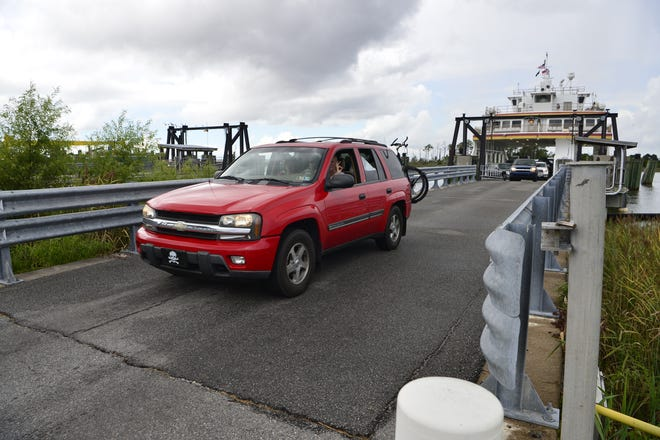 Passengers drive their cars off the Swan Quarter ferry after arriving at the terminal carrying a full load of passengers from Ocracoke Island in accordance with the mandatory evacuation order in preparation for hurricane Florence.