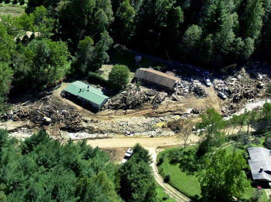 Debris surrounds a group of destroyed houses in the Peeks Creek community near Franklin on Sept. 20, 2004. Heavy rains along with a massive rockslide, caused by the remnants of Hurricane Ivan, claimed at least three lives when it flooded the  area last Friday. Cadaver dogs joined workers with heavy equipment Monday in the search for four people still missing.