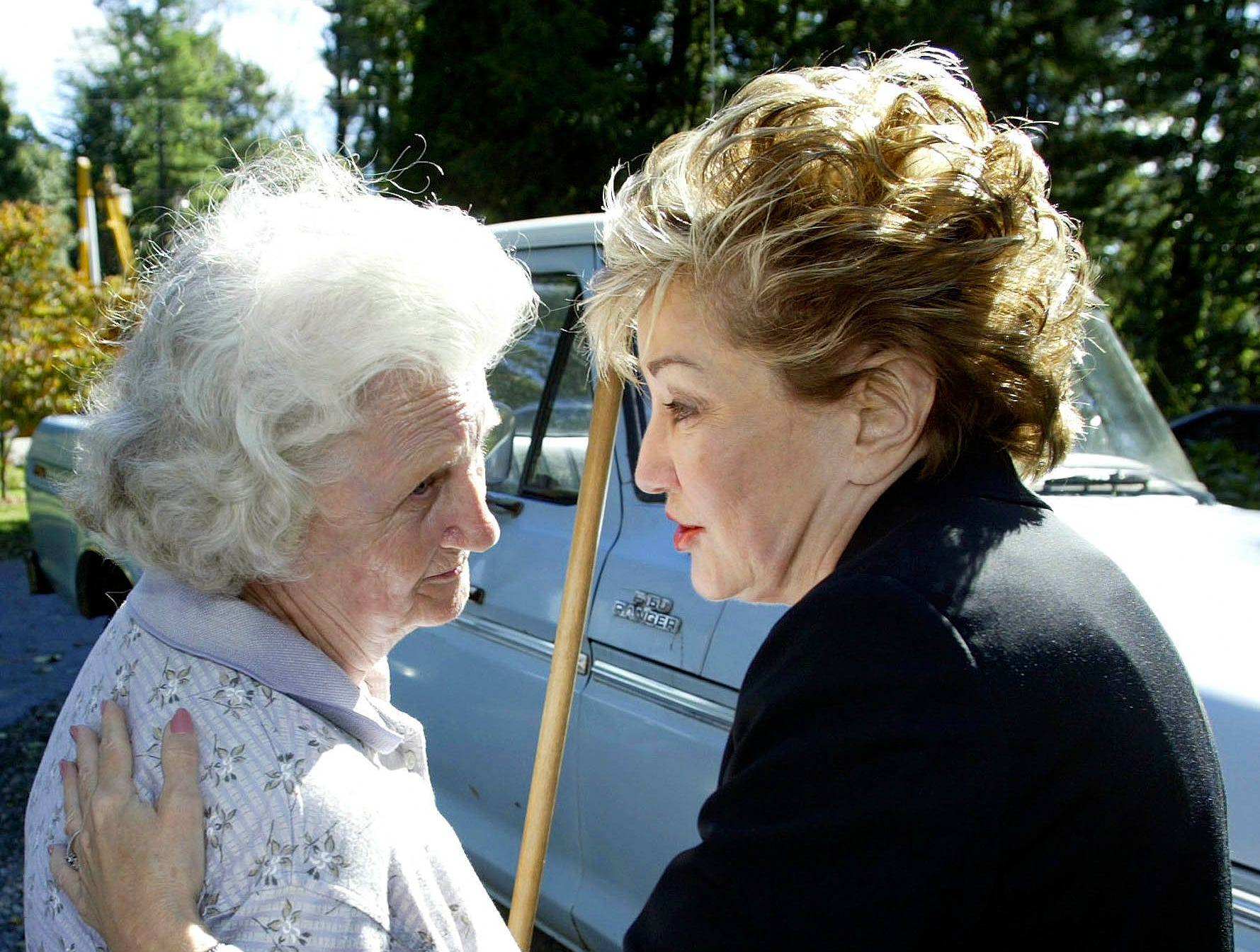 Sen. Elizabeth Dole, R-N.C., right, consoles Mary Hoxit, left, on Sept. 18, 2004, after the remnants of Hurricane Ivan damaged her home in East Flat Rock.