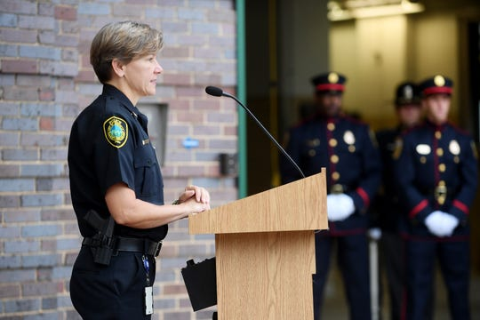 Asheville Police Chief Tammy Hooper speaks during the 9-11 remembrance ceremony at the City Municipal Building Sept. 11, 2018.