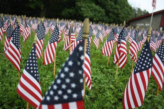 A total of 2,996 small flags were placed outside the United Way of Broome County in Vestal to represent every life lost during the Sept. 11, 2001 attacks on the World Trade Center and Pentagon.
