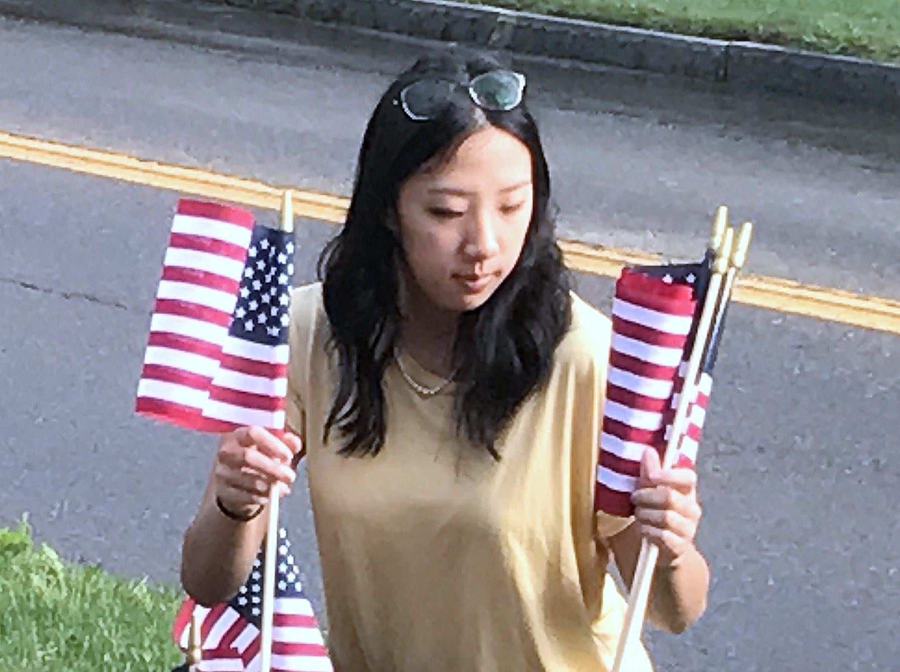 Elmira College student Olivia Cacchione, of Sterling, New York, plants American flags along Park Place in Elmira on Tuesday to commemorate the 17th anniversary of the Sept. 11, 2001 terrorist attacks.