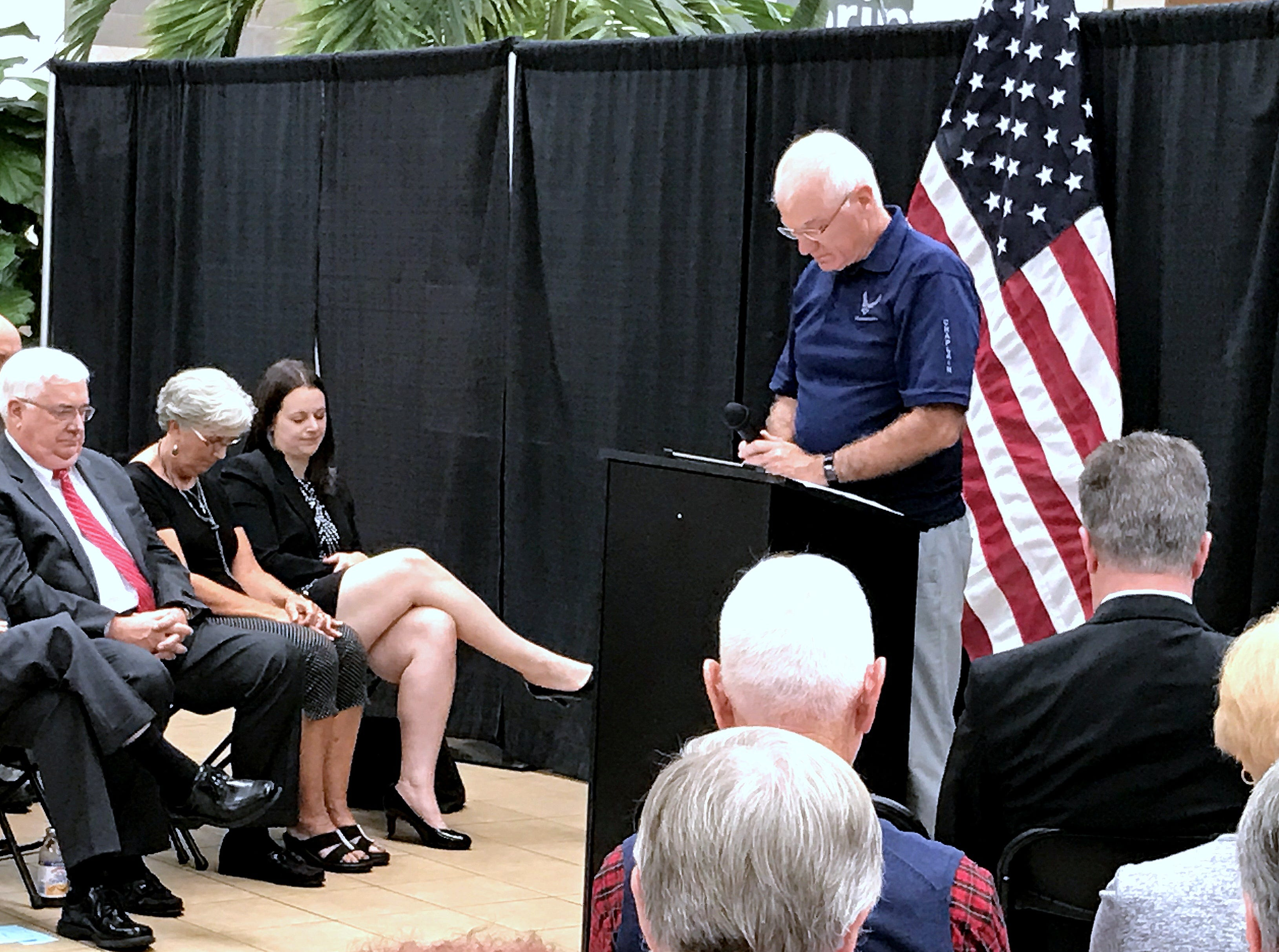 Nationally-syndicated spirituality columnist Norris Burkes leads a moment of prayer Tuesday during a Sept. 11 remembrance at the Arnot Mall in Big Flats.