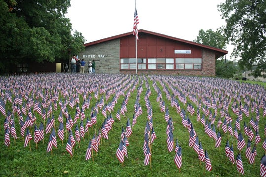 Exactly 2,996 flags were placed outside the United Way of Broome County in Vestal to represent every life lost during the Sept. 11, 2001 attacks on the World Trade Center and Pentagon.