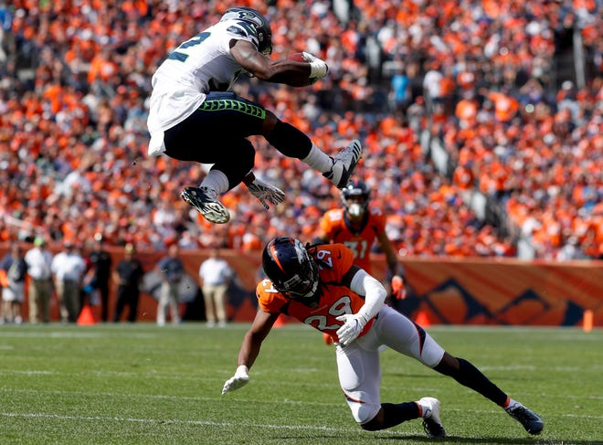 Seahawks running back Chris Carson hurdled Broncos defensive back Bradley Roby during his most spectacular, and effective, carry during Sunday's loss in Denver. Carson gained 51 yards against Denver but had just seven carries. Both totals may need to increase on Monday in Chicago, especially with receiver Doug Baldwin's absence hurting the passing game.